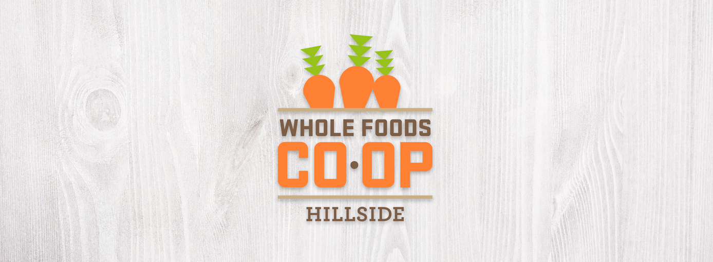 whole foods logo on wood background